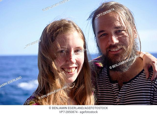 happy Scandinavian Couple next to sea during vacations in Gozo, Malta, Europe