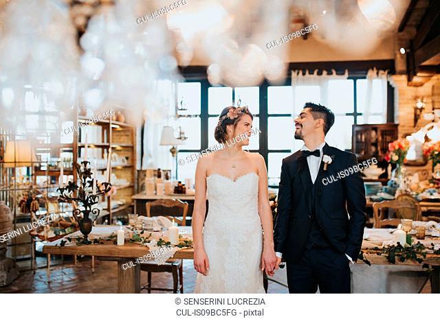 Bride and bridegroom in dining room of wedding reception