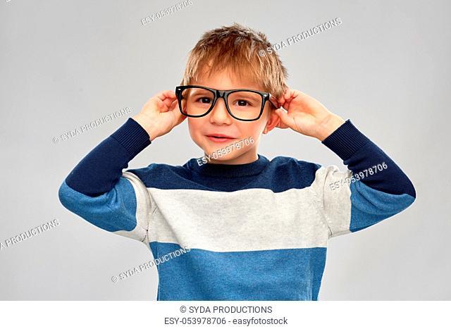 portrait of smiling little boy in glasses