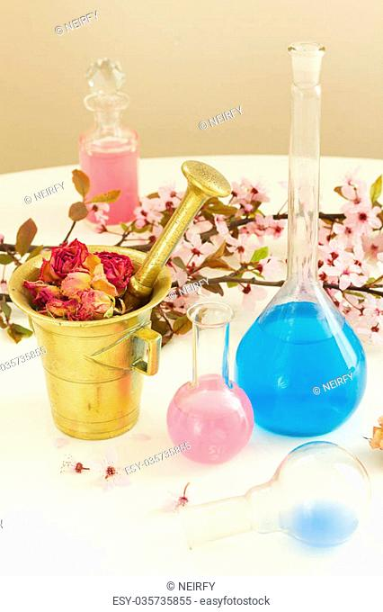 Dry flowers, mortar and vials of tincture or oil, aromatherapy and herbal medicine concept