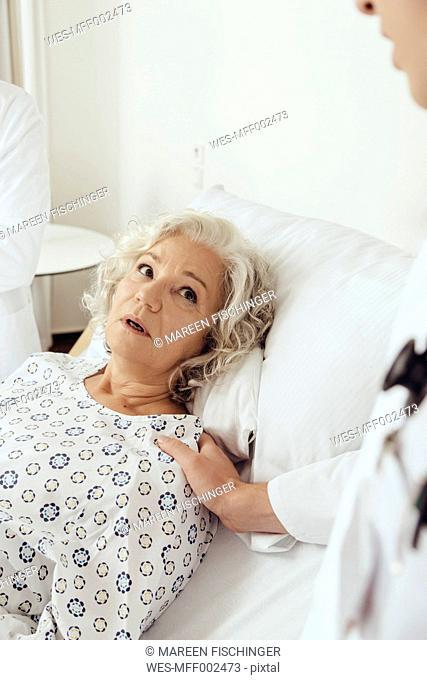 Senior woman in hospital looking worried