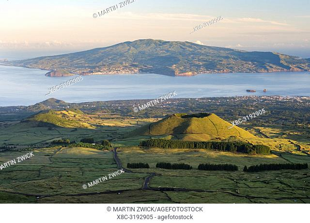 Landscape with craters, Faial island and town Horta in the background. Pico Island, an island in the Azores (Ilhas dos Acores) in the Atlantic ocean
