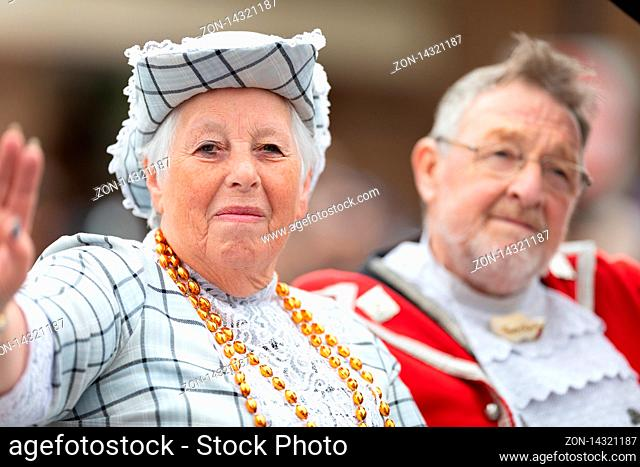 Holland, Michigan, USA - May 11, 2019: Tulip Time Parade, Man and woman wearing traditional dutch clothing going down the street during the parade