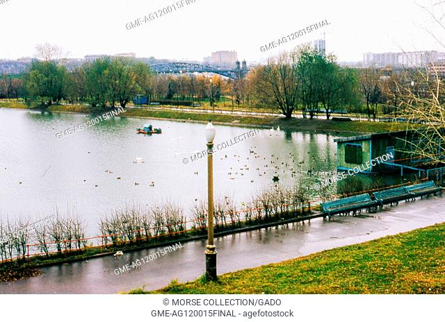 View of the pond known as Swan Lake, at the Novodevichy Convent complex in Moscow, Soviet Russia, USSR, November, 1973. In the background