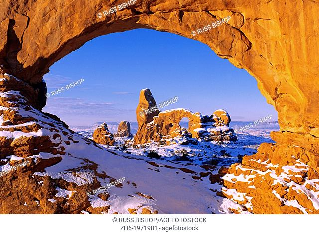 Morning light on North Window framing Turret Arch in winter, Arches National Park, Utah USA