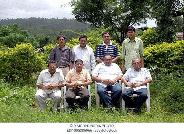 Eight brothers sitting in garden ; Bombay Mumbai ; Maharashtra ; India MR364