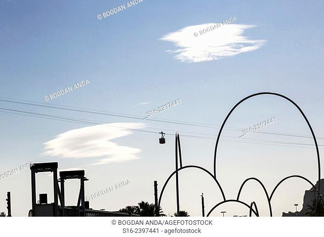 Barcelona, Port Vell's skyline - showing modern sculpture Onades (Waves) by Andreu Alfaro and iconic cable car etc