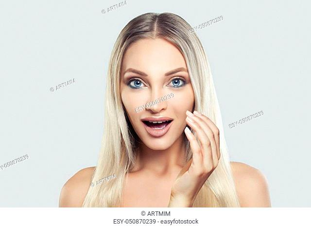Attractive Woman Spa Model with Clean Fresh Skin, Blonde Hair and Open Mouth. Surprised Model on White Background. Product Placement and Advertising Marketing...