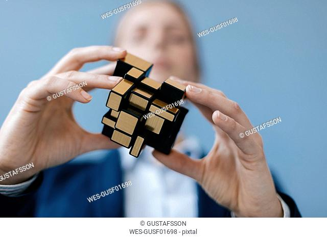 Young woman trying her skills wih a magic cube