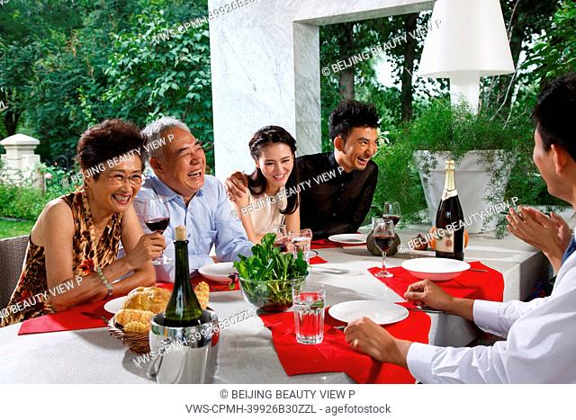 Luxury family having lunch together