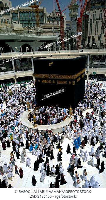 Picture of the Kaaba and a group of pilgrims they walk around to perform Hajj or Umrah, and all Muslims follow its, Located in Mecca in Saudi Arabia