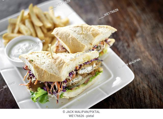 fried battered fresh fish fillet sandwich with coleslaw salad french fries and tartar sauce