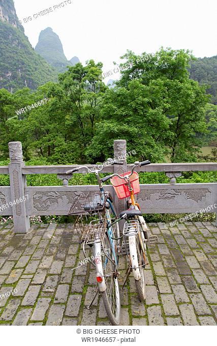 Rental bicycles in a hotel courtyard, Yangshuo, China