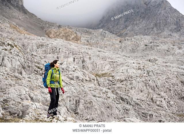 Spain, Picos de Europa, mountaineer in mountainscape