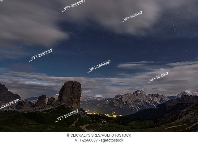 Cinque Torri, Dolomites, Veneto, Italy. Full moon night with stars over the peaks of Cinque Torri