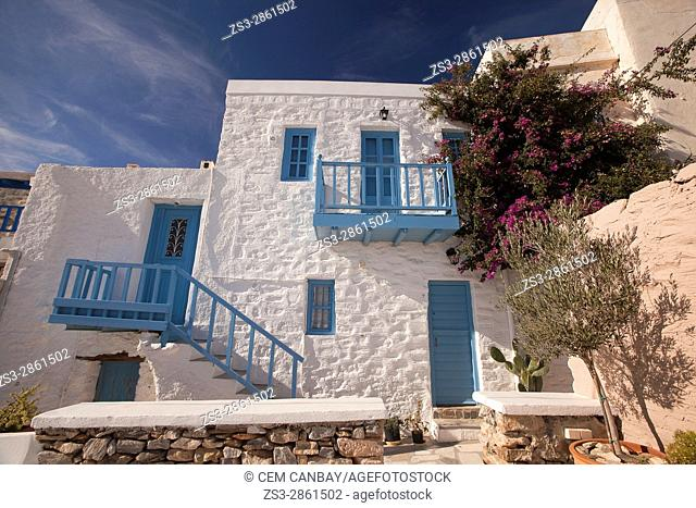 Facade of a whitewashed house with blue balcony, railings and windows in Ano Syros village, Syros, Cyclades Islands, Greek Islands, Greece, Europe