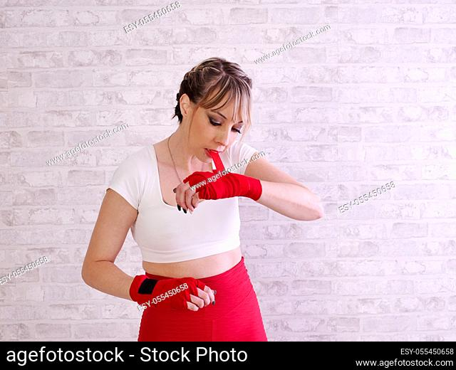 Young woman training and putting on bandages