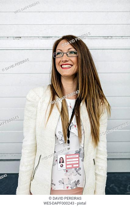 Smiling woman with name tag outdoors
