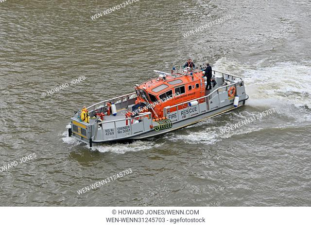 Emergency services search for a man who was reported to have jumped into the River Thames at Westminster Featuring: Emergency services Where: London