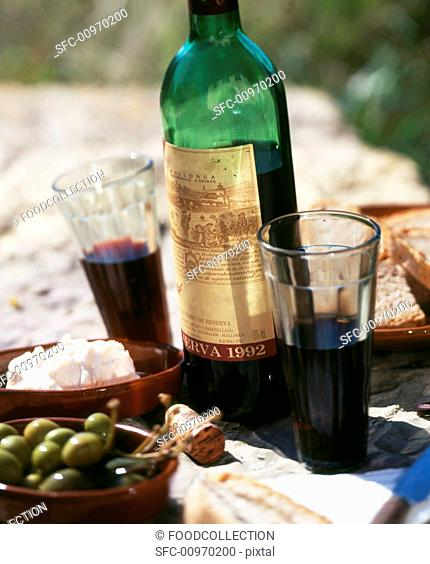Bottle and glasses of red wine, tapas
