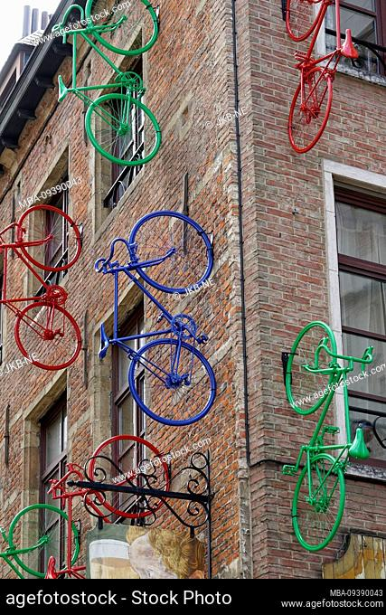Europe, Belgium, Brussels, artwork, facade art, colorful sprayed bicycles mounted on a brick house facade