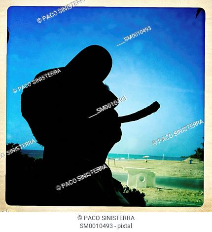 Smoking man joined the sea at Javea, Alicante, Spain