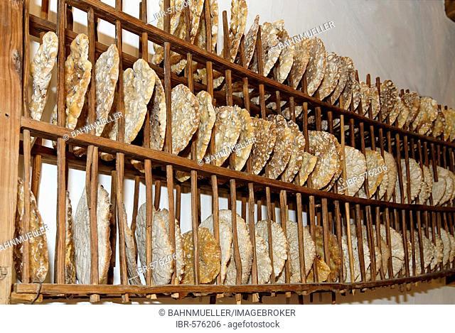 Plattner Bienenhof bee museum, drying Schuettelbrot, traditional bread, near Oberbozen at the Ritten Renon near Bozen Southern Tyrol Italy