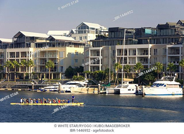 Luxury homes at the Waterfront, in front a luxury yacht, Victoria & Alfred Waterfront, Cape Town, Western Cape, South Africa, Africa