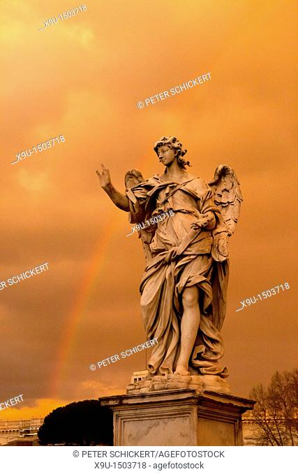 Dark storm clouds and a rainbow over an angel the Bridge of Angels, Rome, Italy, Europe