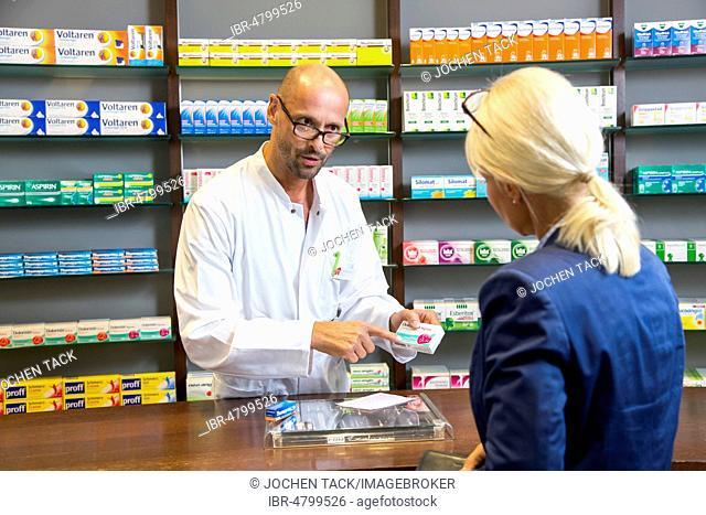Pharmacy, Pharmacist advises a customer who picks up a drug on prescription, Germany