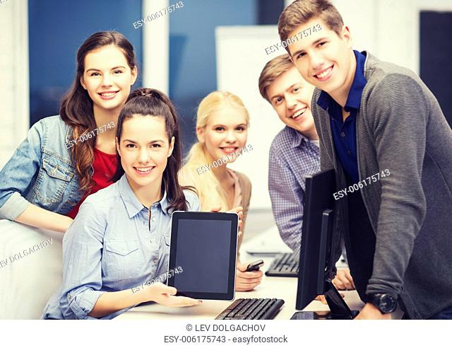 education, technology and internet concept - students with monitor and blank tablet pc screen