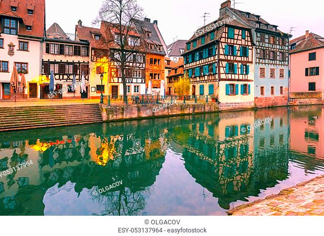 Traditional Alsatian half-timbered houses with mirror reflections in Petite France in the morning, Strasbourg, Alsace, France