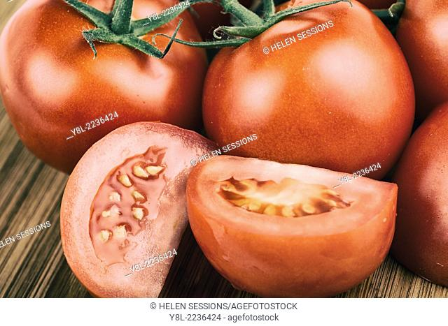 Tomatoes, Whole and Sliced, Chopped Vine Tomato on Cutting Board