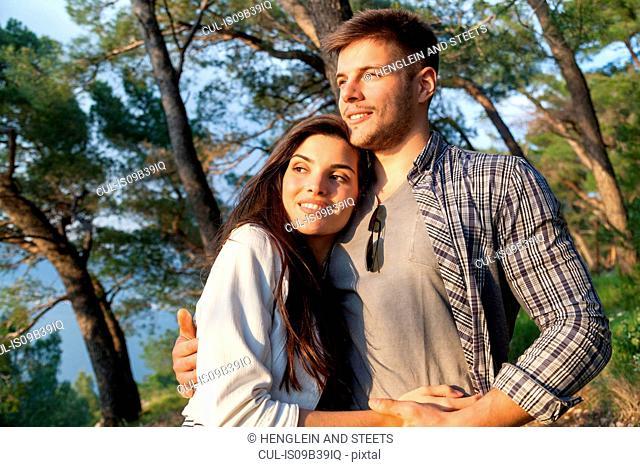 Romantic young couple in coastal forest, Split, Dalmatia, Croatia
