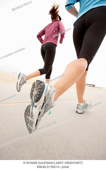 Caucasian women running together