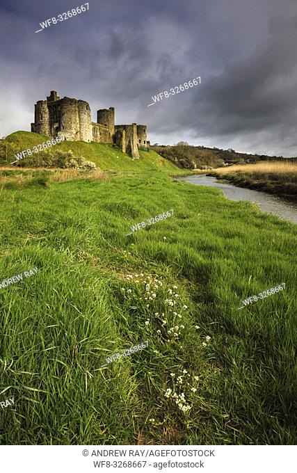 The Norman Castle on the banks of the Gwendraeth Fach in the Carmarthenshire town of Kidwelly, captured on a stormy morning in April