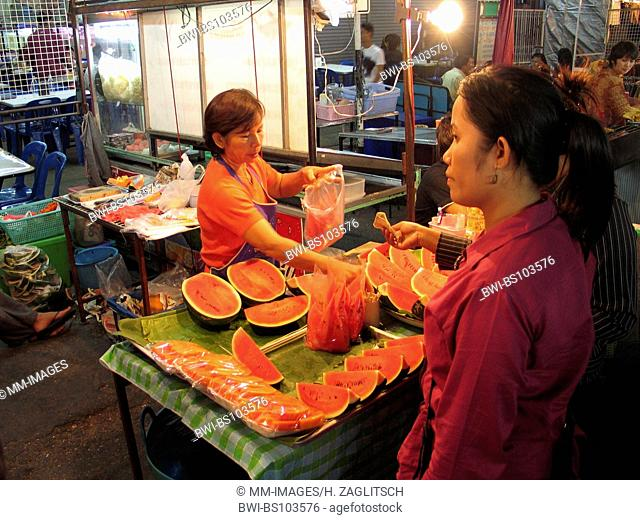 woman selling food at the night market, Thailand, Khorat