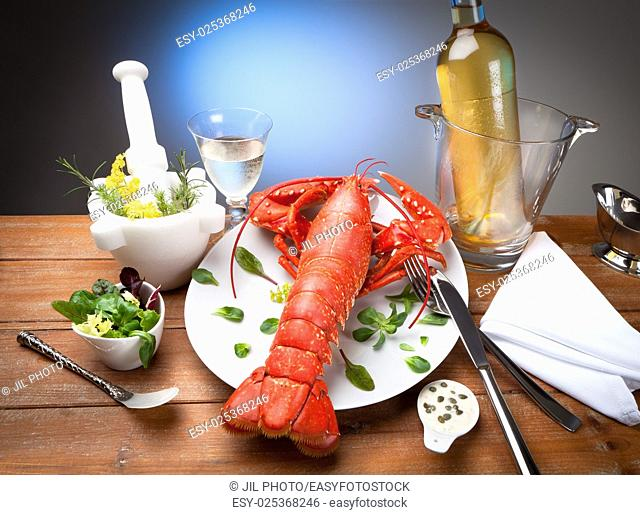 still life of cooked lobster with spices
