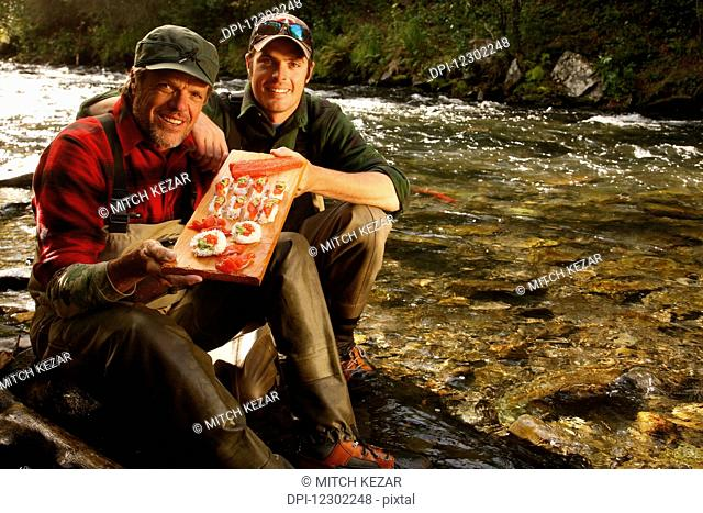 Father and Son with Salmon Sushi On The Shore