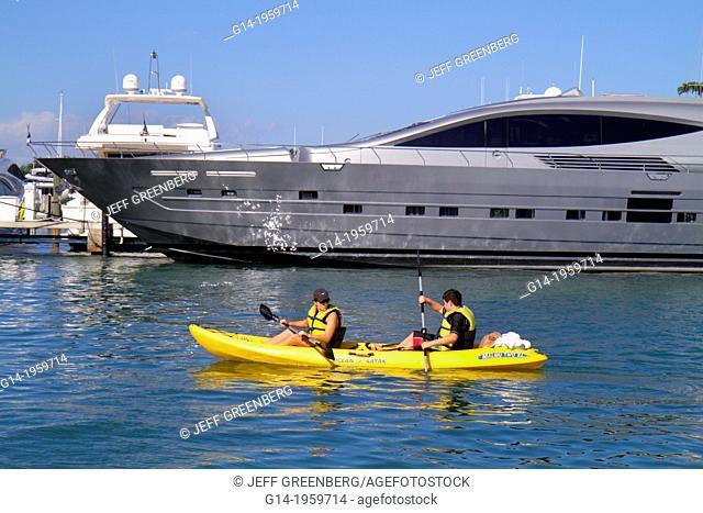 Florida, Miami Beach, Biscayne Bay, marina, boats, super, mega, yacht, kayak, kayakers, woman, paddling, rental,