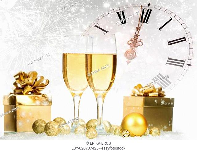 Champagne and gift box against fireworks and holiday lights