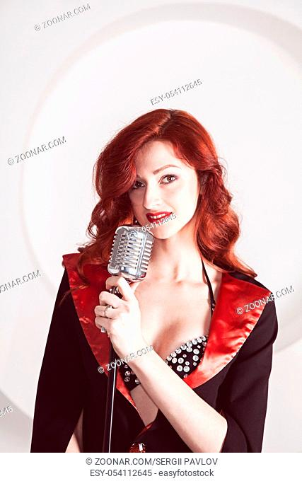 singing redhead in red dress