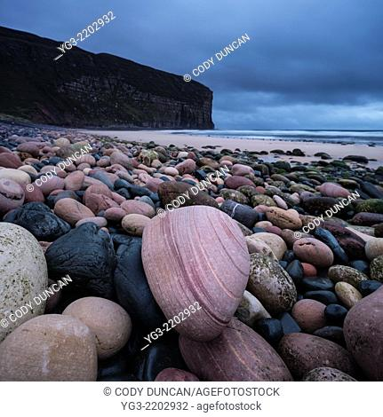 Red sandstone boulders on beach at Rackwick Bay, Hoy, Orkney, Scotland
