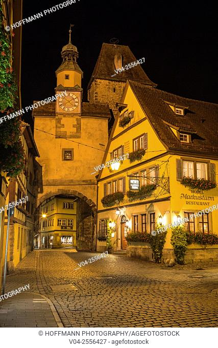 12th century Markusturm (Markus Tower) and Röderbogen (Roeder Arch) with timbered houses at night, Rothenburg ob der Tauber, Bavaria, Germany, Europe