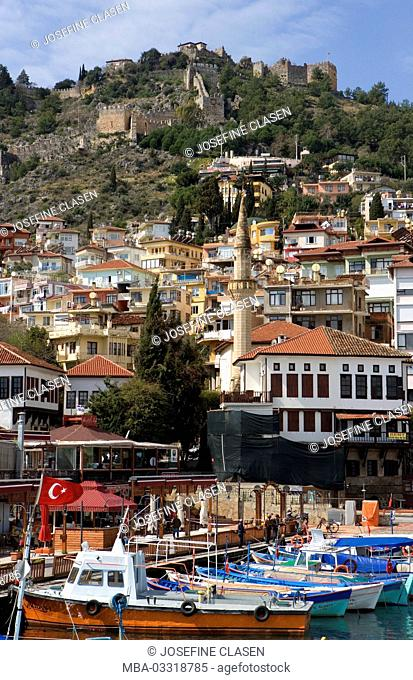 Turkey, Alanya, south coast, harbour, fishing boats, mosque, minaret, in the background the castle mountain and the old city wall, houses