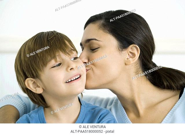 Mother kissing son on the cheek