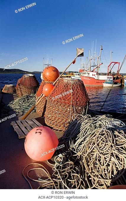 Fishing nets and crab traps on the dock on Sandwich Bay in Cartwright, Labrador, Newfoundland and Labrador, Canada