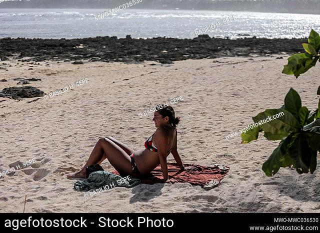 A tourist relaxes on the shore in SIargao Island, Surigao del Norte province south of Manila, Philippines