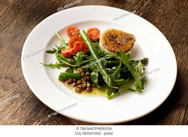 Plate of peppered fried goats cheese and salad
