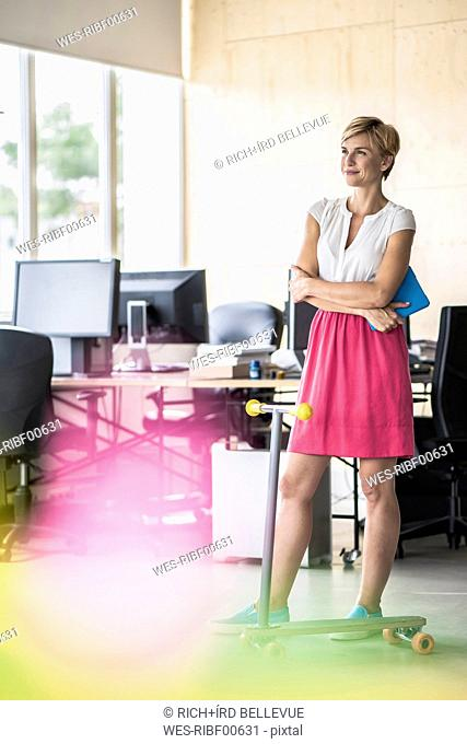Woman standing in creative office
